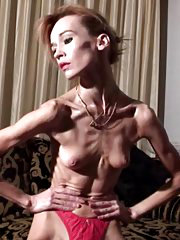 Skinny Inna posing in the room showing her very thin body